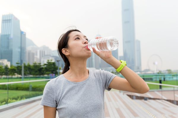 asian-young-woman-drink-of-the-water-bottle-CGR6MVJ.jpg