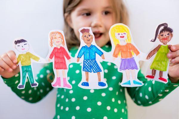 girl-holding-paper-homemade-garland-of-people-of-d-NMGDMCJ.jpg