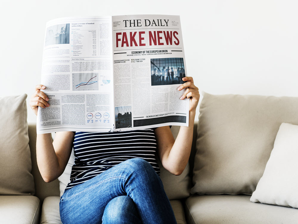 woman-reading-newspaper-P49ZLDY.jpg