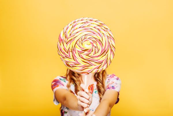 woman-with-huge-candy-instead-of-a-head-PJTV4L5.jpg