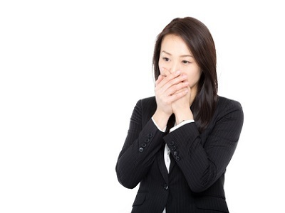 woman-touch-mouth-hands-business suit