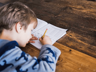 boy-write-pen-test-notebook-table.png
