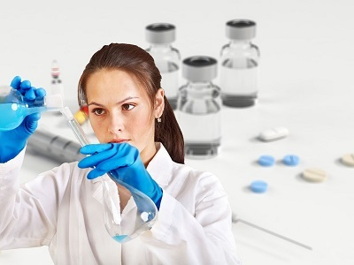 woman-doctor-white-coat-experiment-flask-400x300.jpg