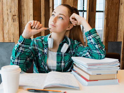 woman-student-think-books-pen-cup-table-room.png