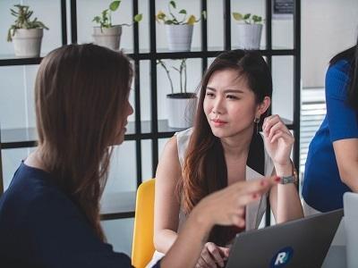 women-talk-laptop-room.jpg