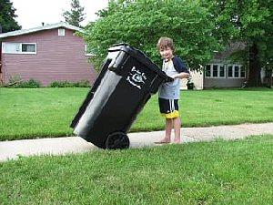 03c 300 boy holding trash bin