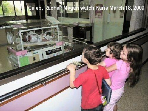 04b 20090318 3 kids watching baby