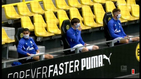 Schalke players took their seats on a newly formed substitute bench that adhered to social distancing rules