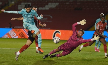 Takumi Minamino scores Liverpool's fifth goal against Lincoln in the Carabao Cup
